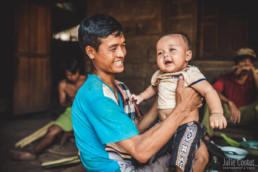 Father and son in a village around Luang Prabang
