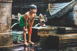 Young boy at Tirta Empul Tampak Siring - Bali Holy Spring Water Temple